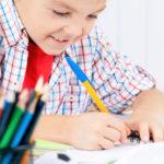 boy using organized homework station