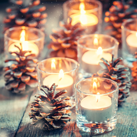 holiday candles and pine cones