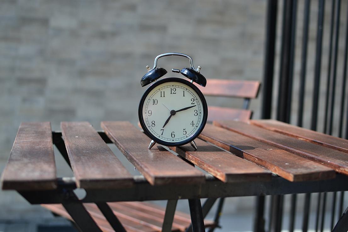 an alarm clock on a table