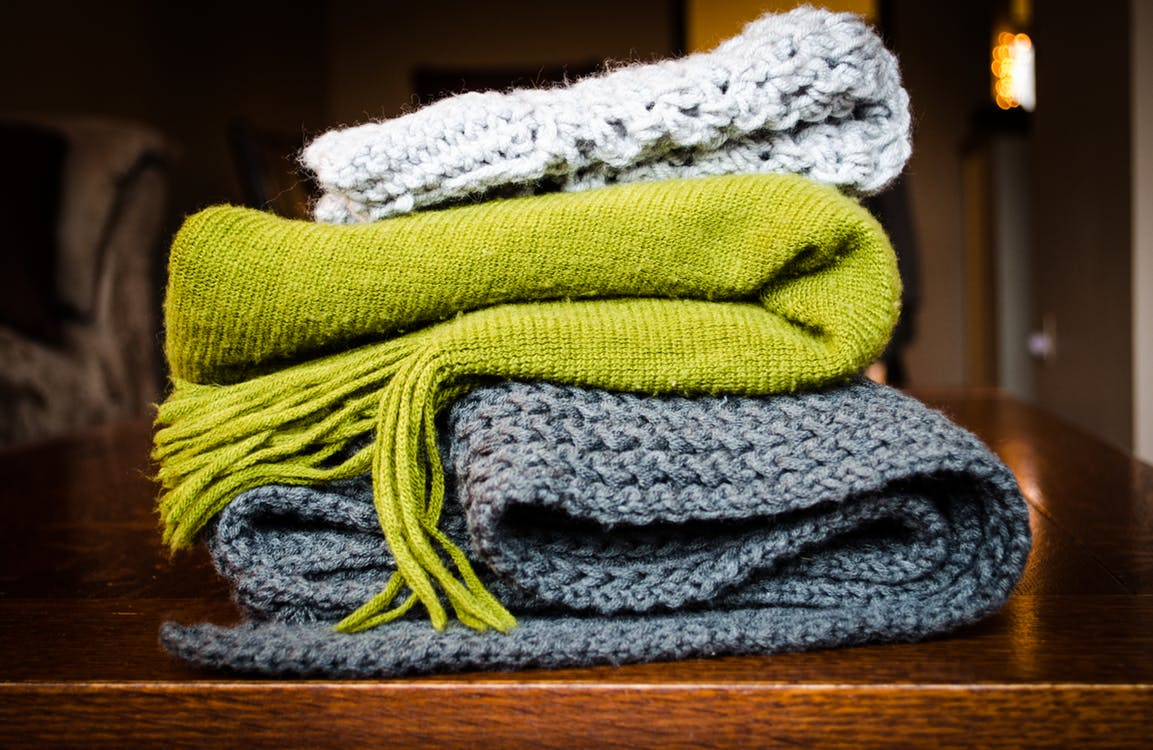 pile of disorganized scarves