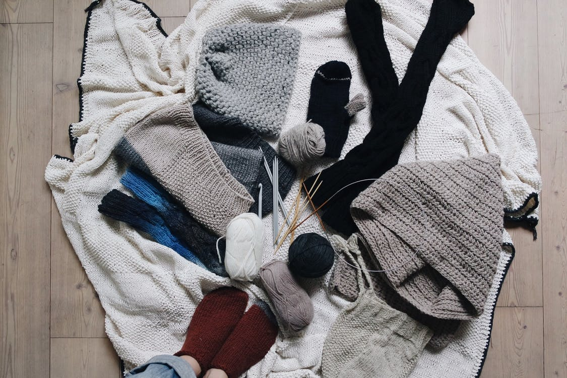 yarn and knitted items on a blanket
