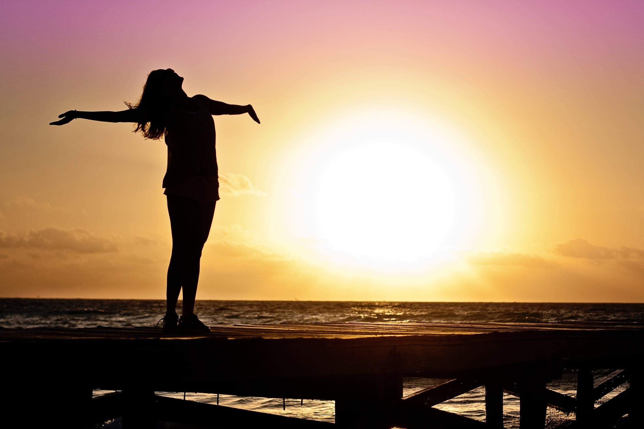 woman free at sunset
