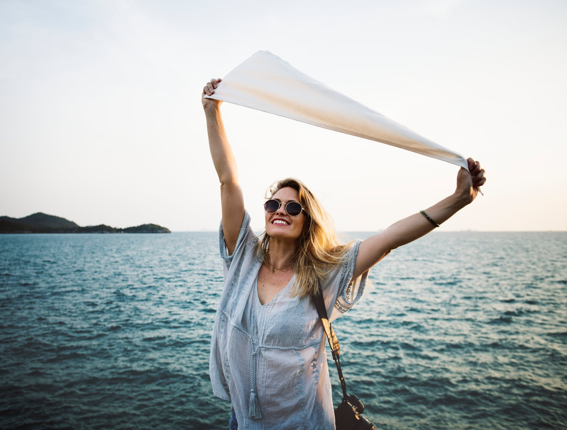 happy organized woman by the ocean