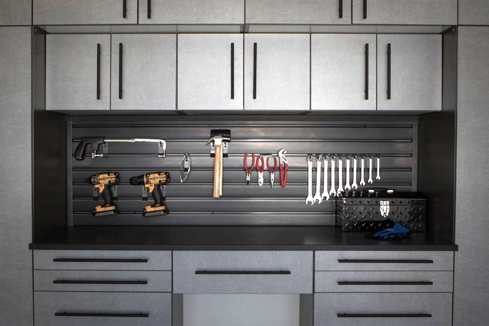 organized garage tools and cabinetry