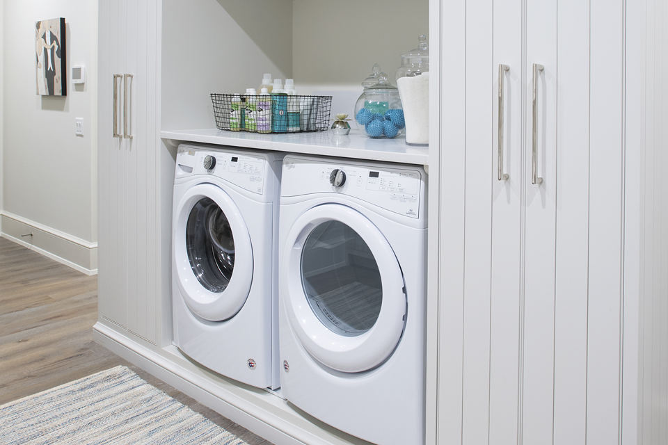staged laundry room to sell