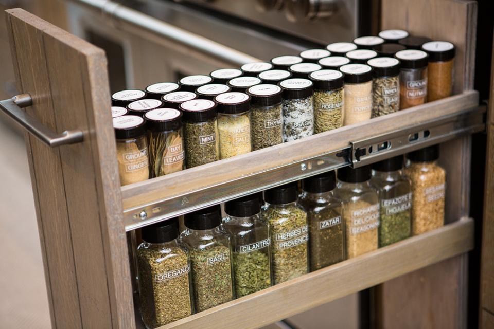 organized spice drawer in a modern kitchen