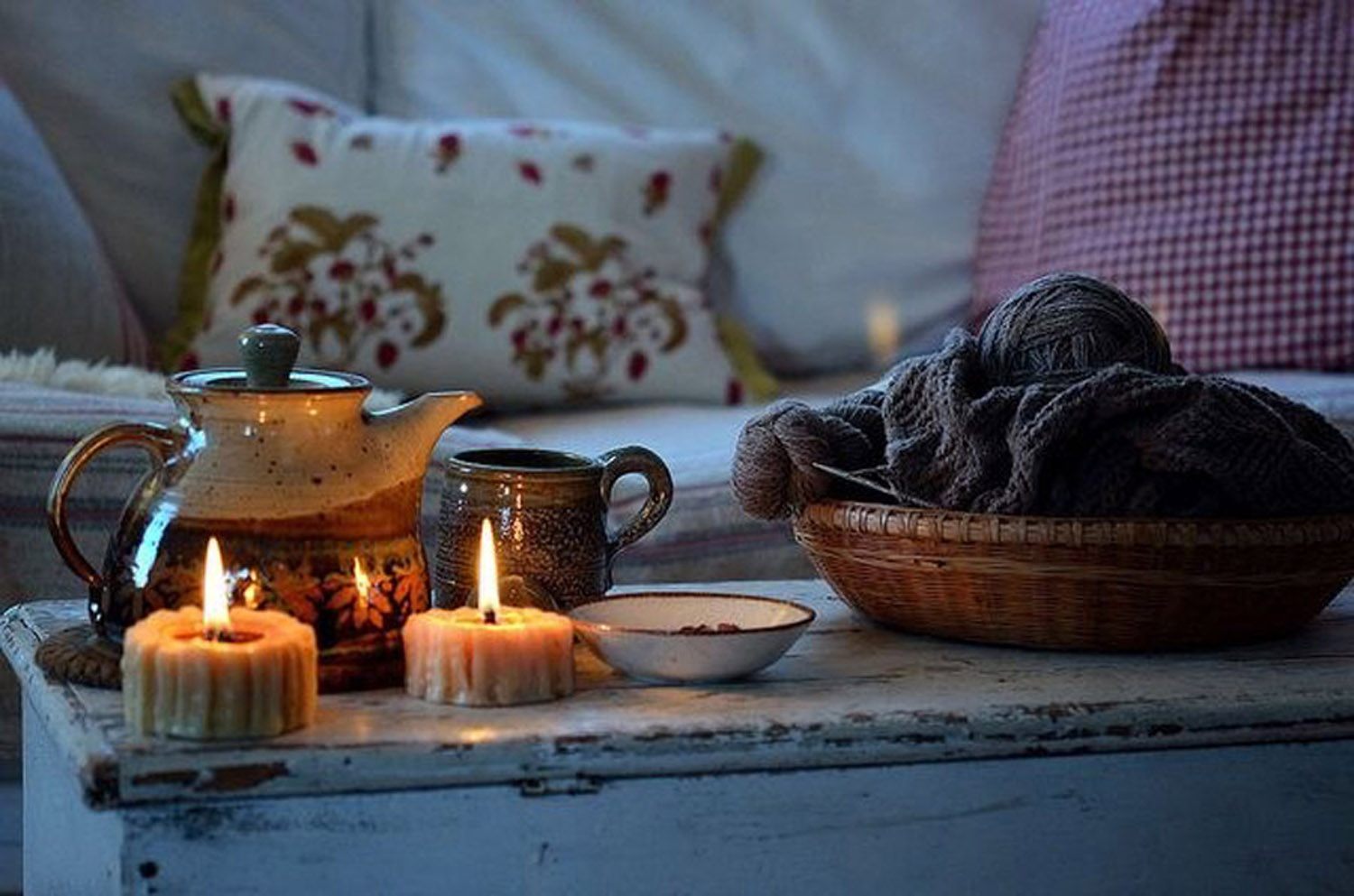 hygge cozy nook with candles and tea