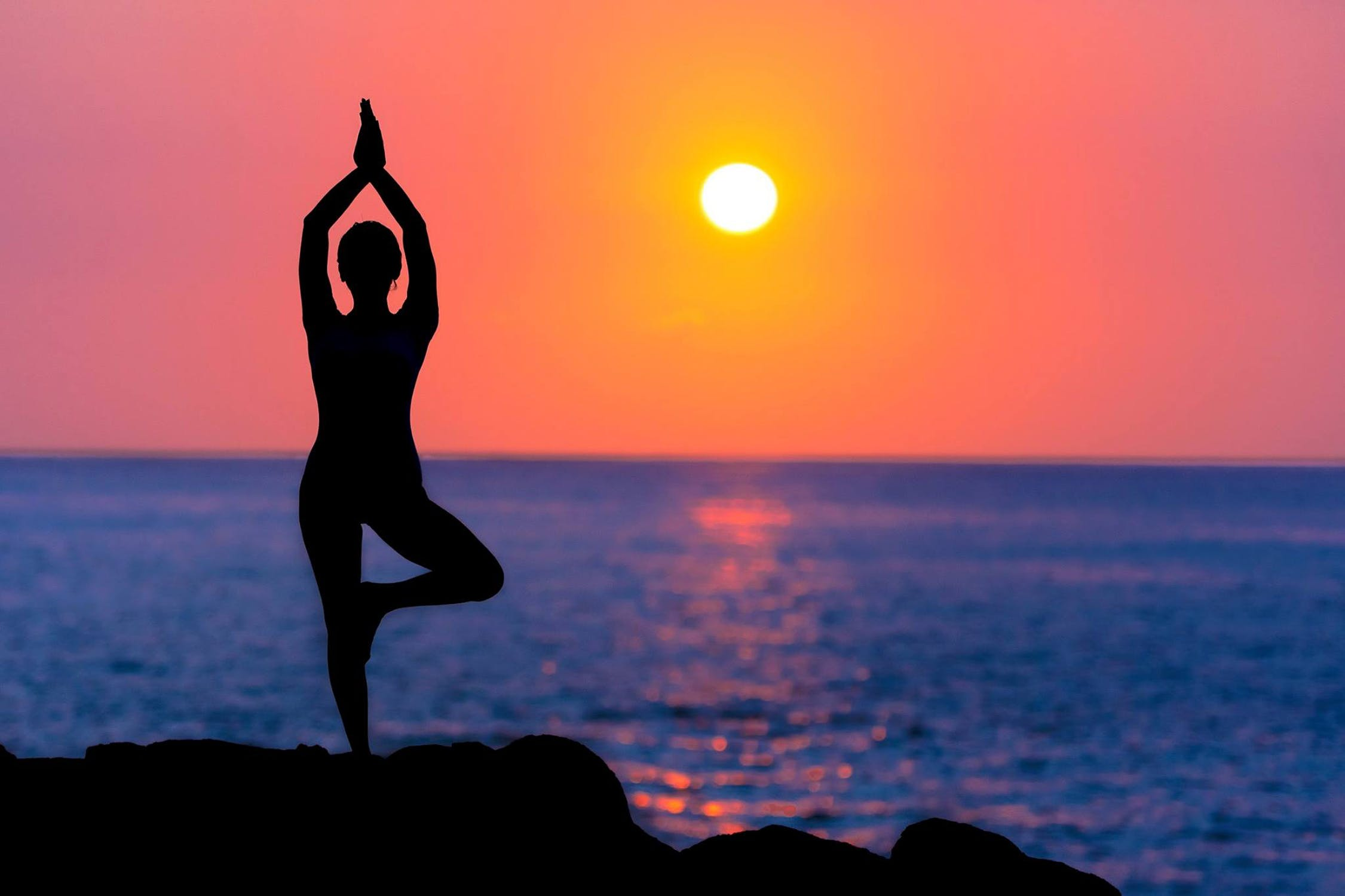 sunset yoga pose