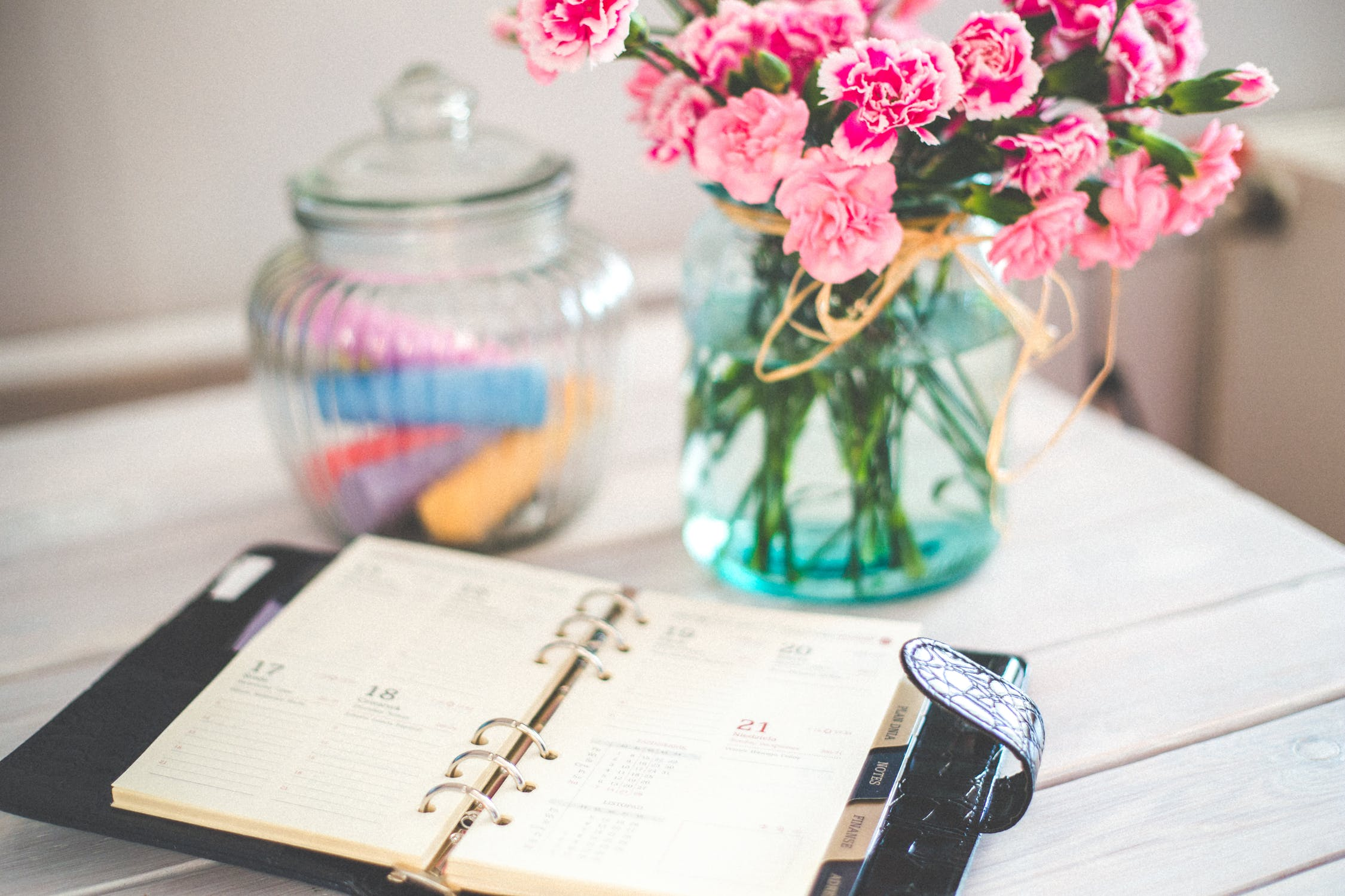 agenda on desk with flowers