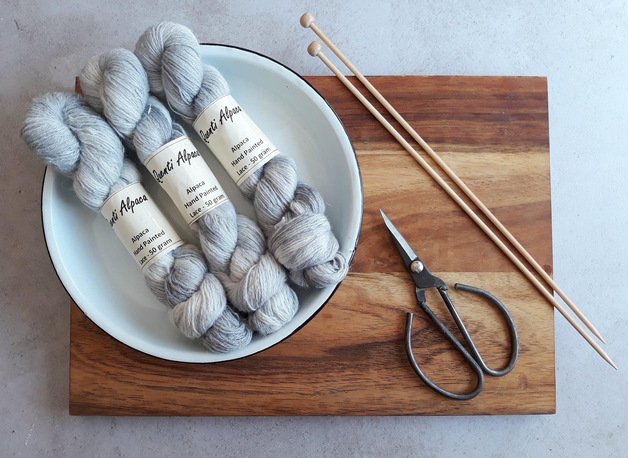 knitting yarn, needles and scissors