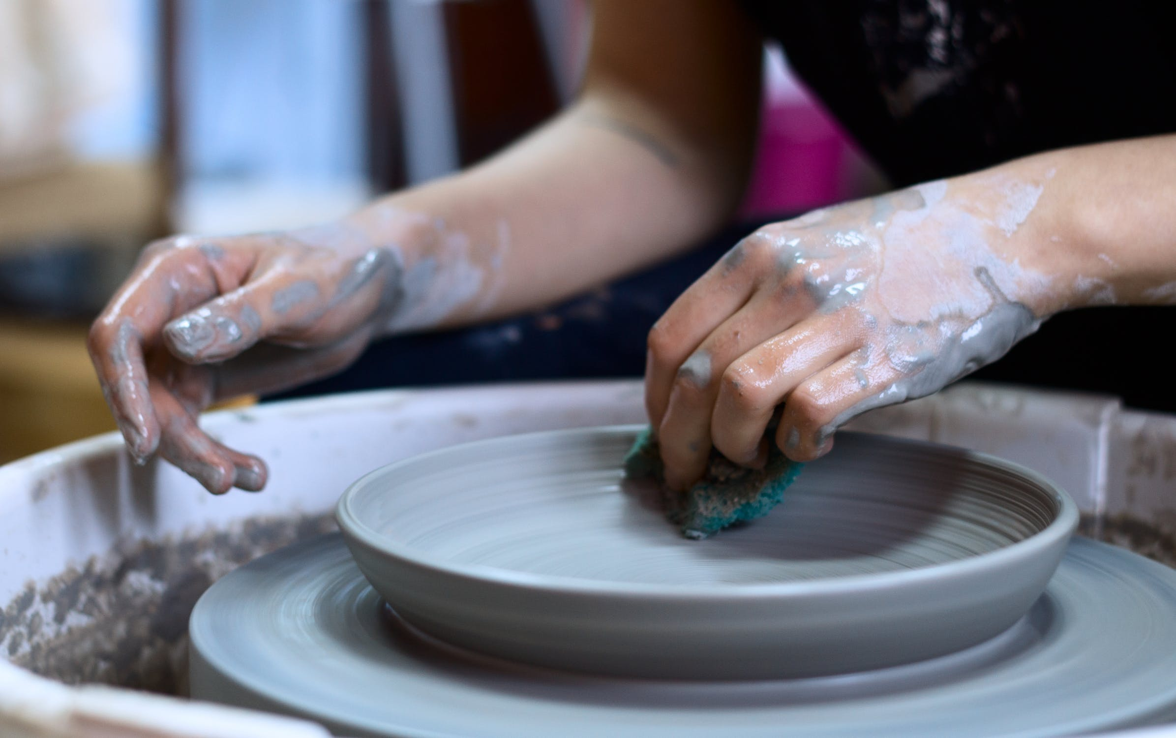 throwing a plate on a pottery wheel